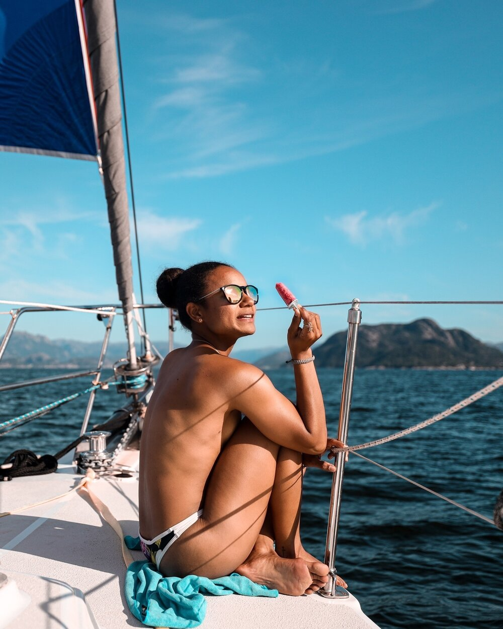 ☀️  Being able to soak up the sun while enjoying the epic view from the bow of my sailboat, with enough wind to fill her sails, is my current definition of
